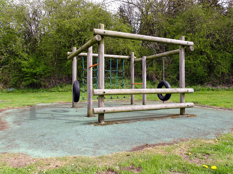 Photo of climbing frame in children's area in Powburn