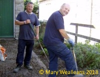 Johnny and Nigel tidying the bedding area