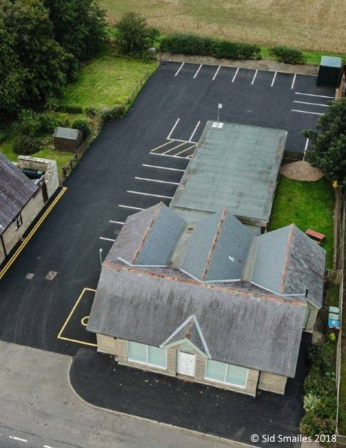 Aerial view of the Breamish Hall showing building and car park