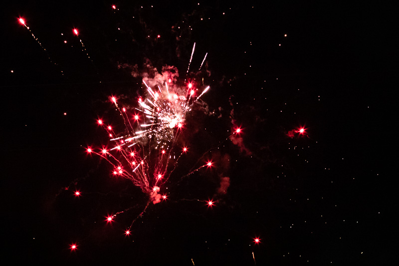 Red and white fireworks in night sky