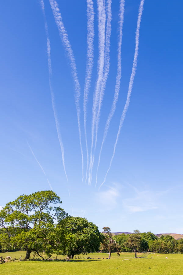 contrails heading to Holy Island