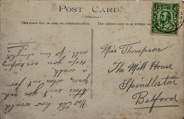 Reverse side of postcard of a bridge over the Pow Burn