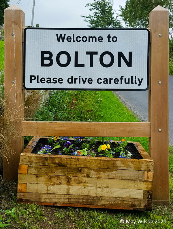 Bolton Village road sign planter with bedding plants