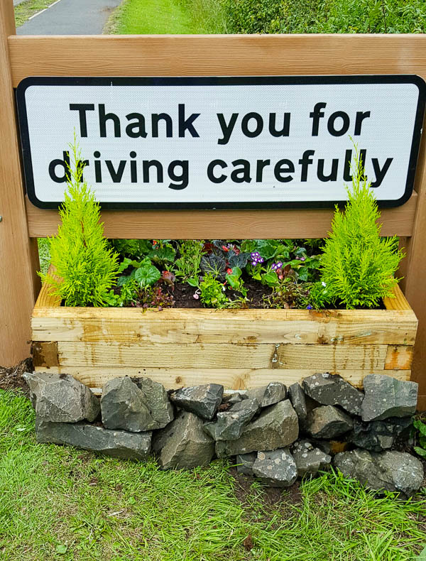 middle road sign planter at Powburn completed