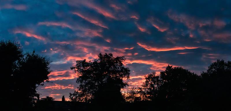 View of sunset over Powburn skyline