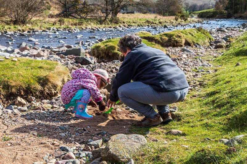 Child and adult playing at Bulby's Wood riverbank Marc h 2016