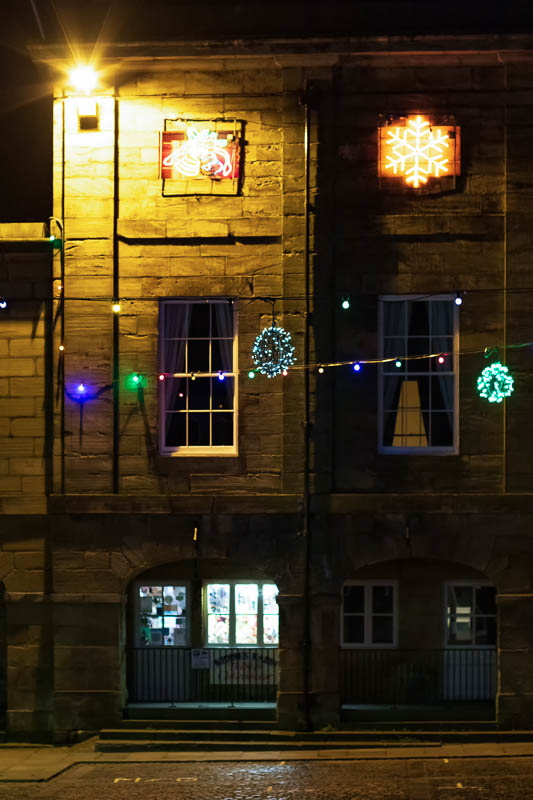 Night time photo of decorated old buildings in Alnwick