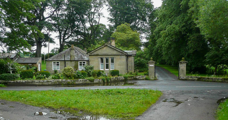 Photo of West Lodge at Shawdon Hall showing pillars at driveway entrance