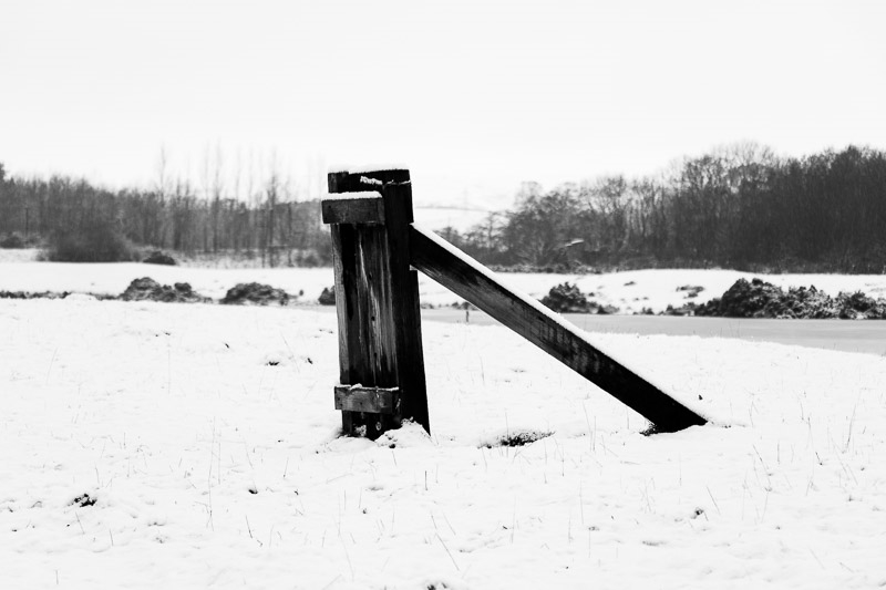 Photo of wooden post in snow