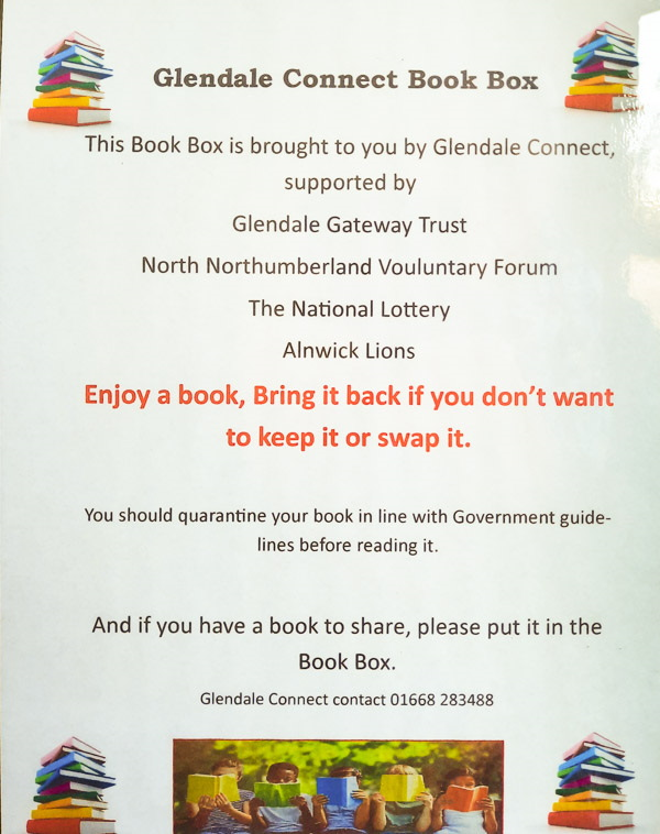 Photo reproduction of a poster advertising the book box