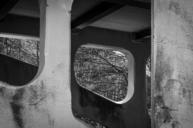 Black and white photo of supporting arch on a bridge