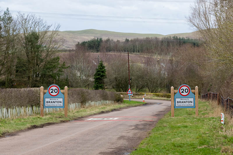 Photo of two 20 mph road signs and a school warning road sign