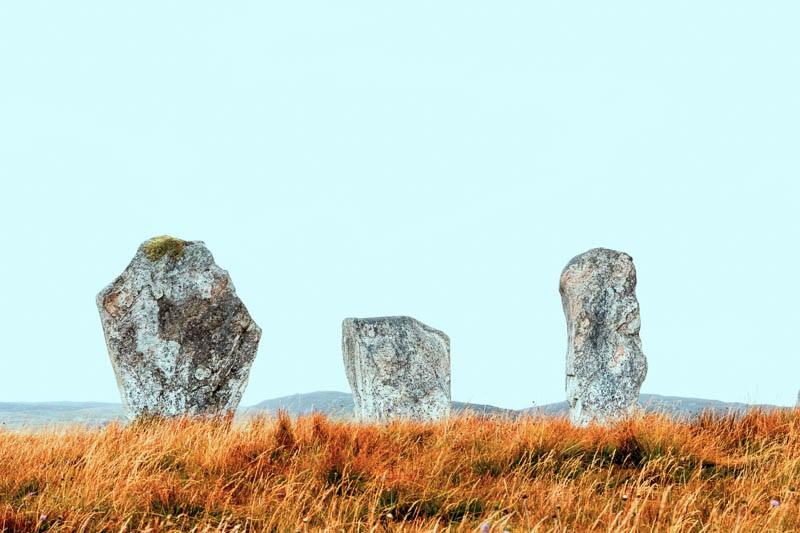 Colour photo of three standing stones