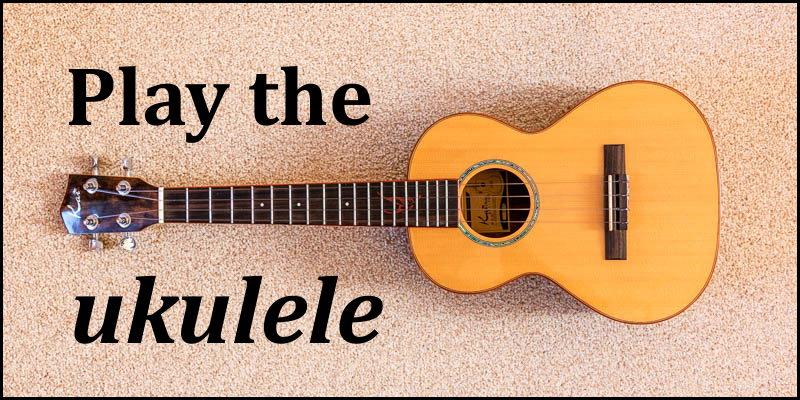 Photo of a ukulele overlaid with the words 'Play the ukulele'