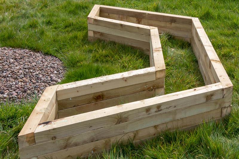 Close up photo of u-shaped wooden planter
