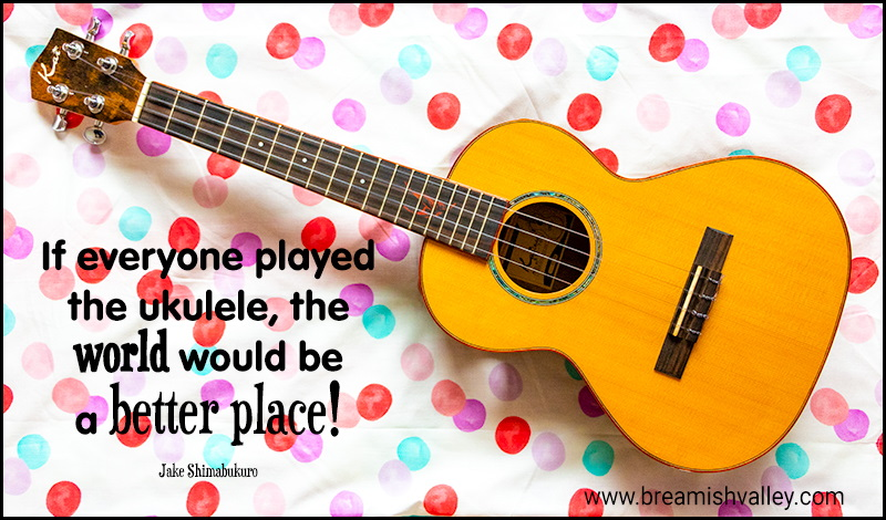 Poster with photo of ukulele with the words 'If everyone played the ukulele, the world would be a better place!'