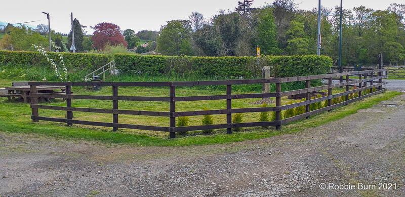 Photo showing treated fence around community garden