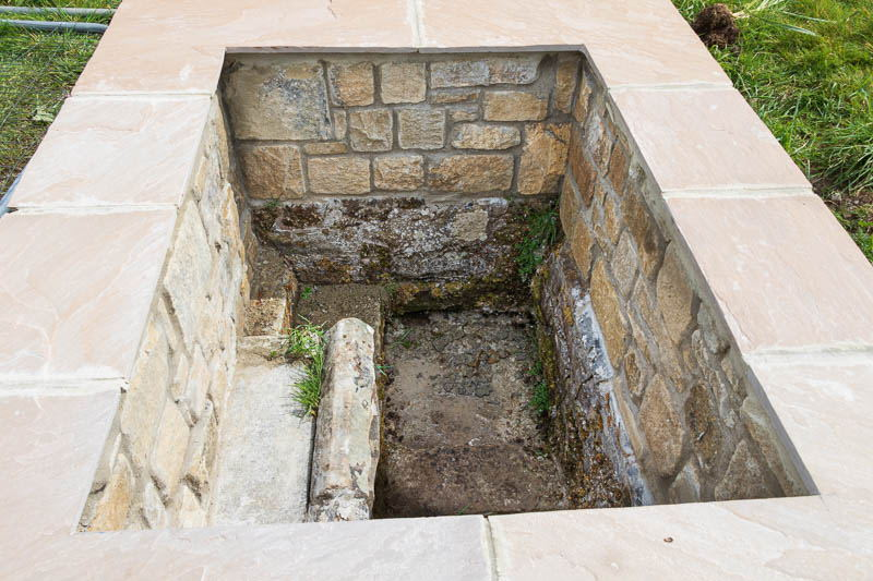 Photo looking down into the newly walled well at Powburn
