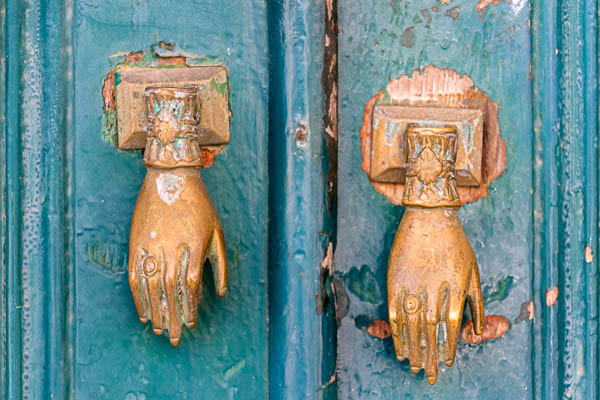 Photo of two door knockers shaped like hands